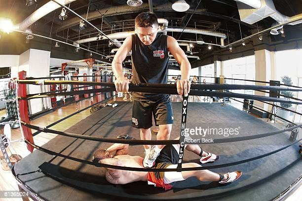 Football Portrait of San Diego Chargers Shawne Merriman in action demonstrating crunches exercise during workout at The Boxing Club La Jolla CA...