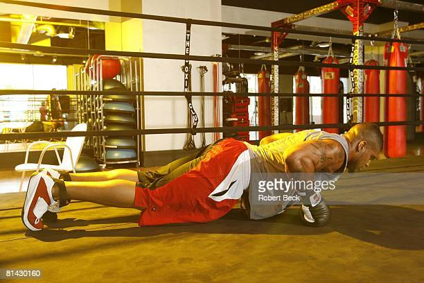 Football Portrait of San Diego Chargers Shawne Merriman in action demonstrating push up exercise during workout at The Boxing Club La Jolla CA...