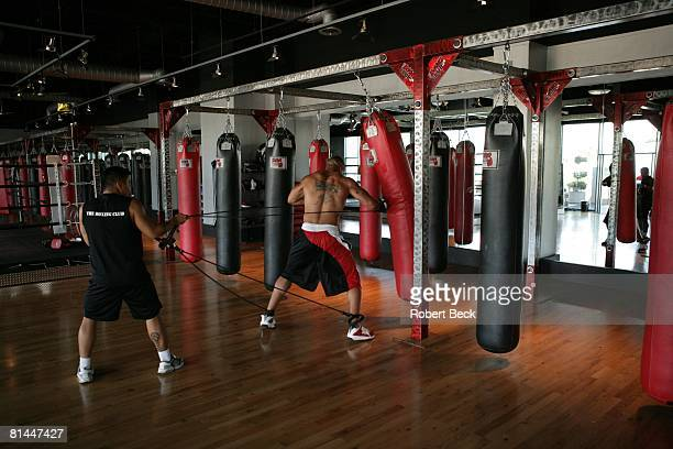 Football Portrait of San Diego Chargers Shawne Merriman in action demonstrating heavy bag exercise during resistance training workout at The Boxing...