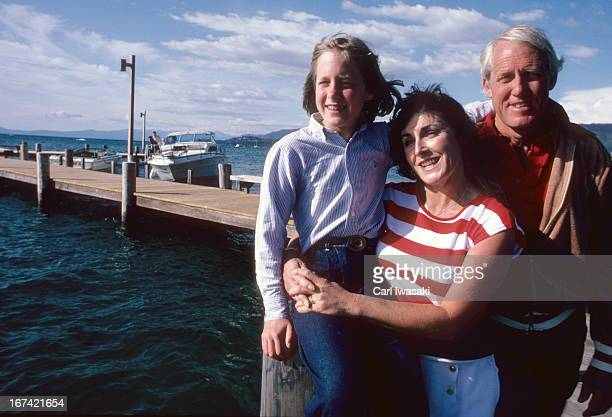Portrait of San Francisco 49ers head coach Bill Walsh with his wife Geri and daughter Elizabeth during photo shoot on dock Lake Tahoe NV CREDIT Carl...