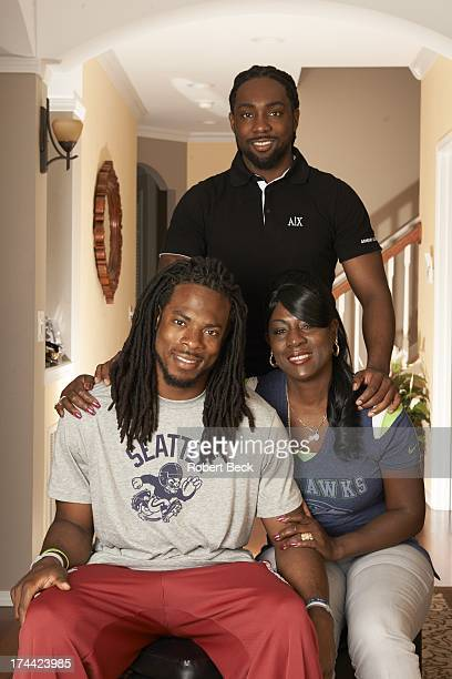 Portrait of Seattle Seahawks Richard Sherman posing with his brother Branton and his mother Beverly during photo shoot at his home Seattle WA CREDIT...