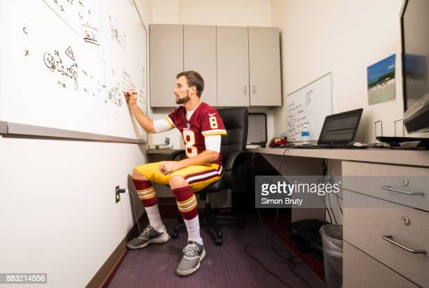 Portrait of Washington Redskins QB Kirk Cousins writing on dry erase board during practice session photo shoot at Redskin Park Ashburn VA CREDIT...