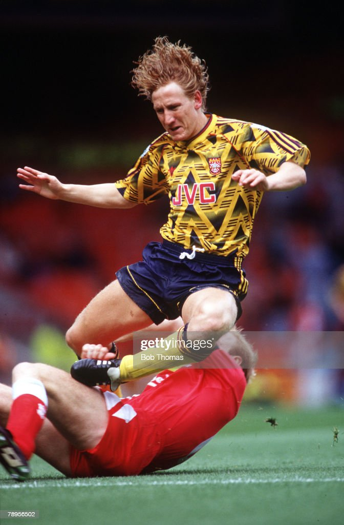Football. Premier League. Liverpool, England. 23rd August 1992. Liverpool 0 v Arsenal 2. Arsenal's Ray Parlour is brought down by Liverpool's Mark Wright during the league match at Anfield. : News Photo