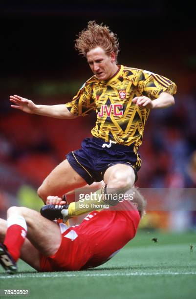 Football Premier League Liverpool England 23rd August 1992 Liverpool 0 v Arsenal 2 Arsenal's Ray Parlour is brought down by Liverpool's Mark Wright...