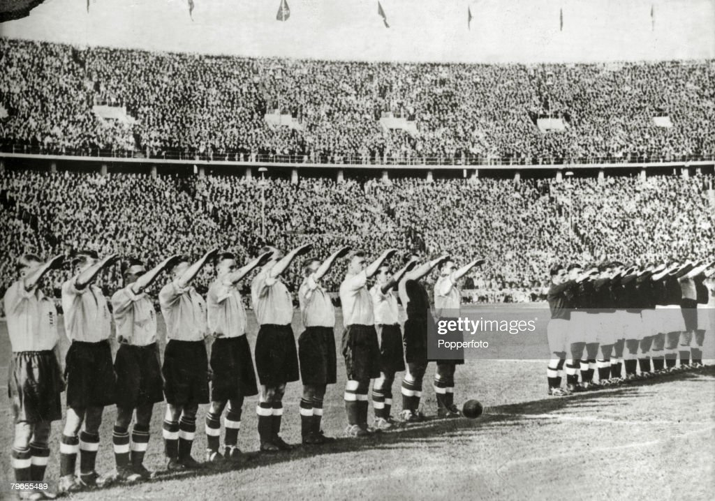 Football, Pre-World War Two, pic: 14th May 1938, Berlin, Prior to their international match with Germany in the Olympic Stadium, the England team left, give the Nazi salute alongside the Germans, as the German National Anthem is played, England beat Germa : News Photo