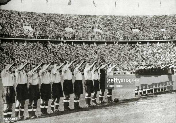 14th May 1938 Berlin Prior to their international match with Germany in the Olympic Stadium the England team left give the Nazi salute alongside the...