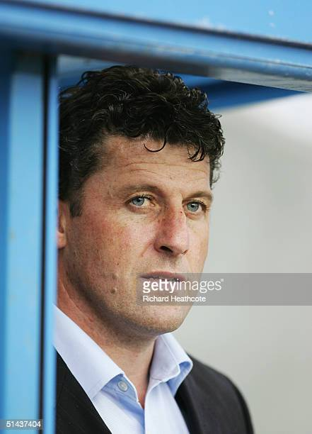 ITV football pundit Andy Townsend watches the action during the CocaCola Championship match between Reading and Burnley at Madejski Stadium on...