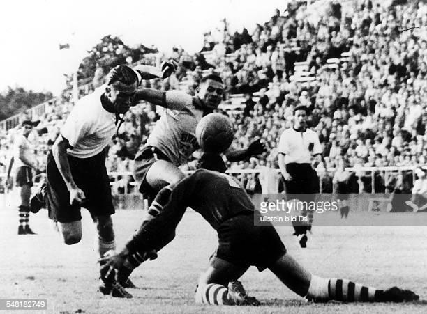 Football quarter final between Germany and Brazil German player Kurt Sommerlatt scoring a goal with a header July 1952