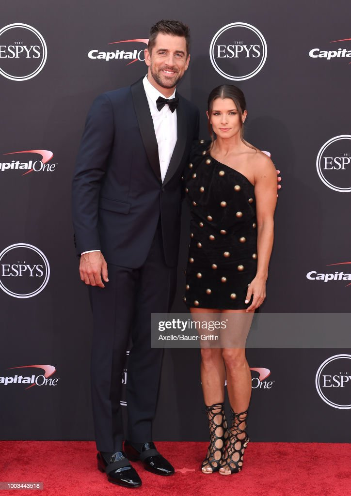 Football quarterback Aaron Rodgers and racing driver Danica Patrick attend The 2018 ESPYS at Microsoft Theater on July 18, 2018 in Los Angeles, California.