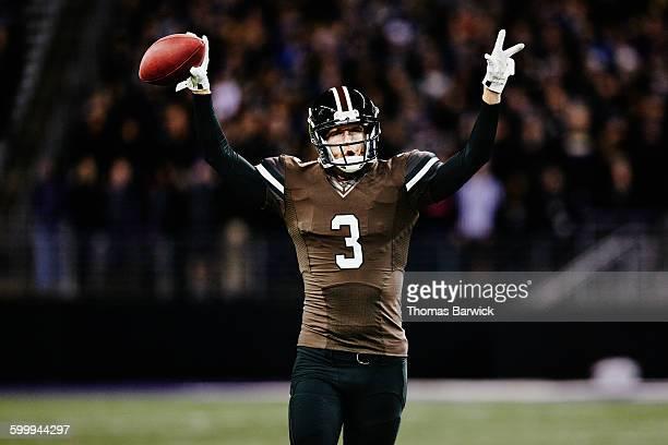 Football quarterback celebrating on field