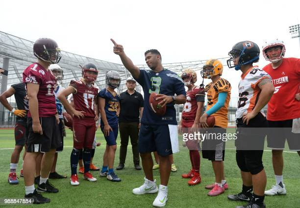 US football quarterback Russell Wilson takes part in a training session at a football camp in Shanghai on July 1 2018 / China OUT