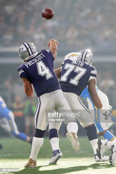 Rear view of Dallas Cowboys QB Dak Prescott in action passing vs Los Angeles Chargers at ATT Stadium Arlington TX CREDIT Greg Nelson