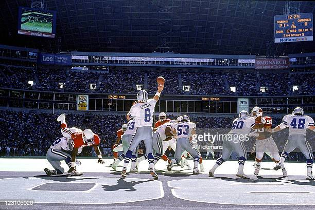 Rear view of Dallas Cowboys QB Troy Aikman in action passing vs Phoenix Cardinals at Texas Stadium Irving TX CREDIT Al Tielemans