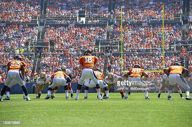 Rear view of Denver Broncos QB Peyton Manning calling signals before snap during game vs San Francisco 49ers at Sports Authority Field at Mile High...
