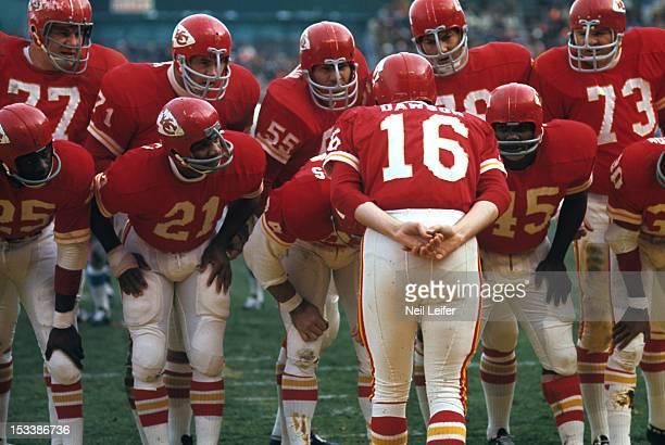 Rear view of Kansas City Chiefs QB Len Dawson in huddle with team during game vs Houston Oilers at Municipal Stadium Kansas City MO CREDIT Neil Leifer