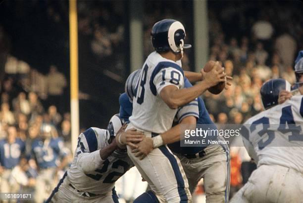 Rear view of Los Angeles Rams QB Roman Gabriel in action vs Detroit Lions at Tiger Stadium. Detroit, MI 11/1/1964 CREDIT: Marvin E. Newman