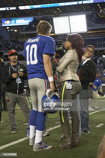 Rear view of New York Giants QB Eli Manning during interview with Fox Sports reporter Pam Oliver after game vs Dallas Cowboys at Cowboys Stadium...