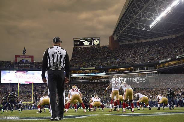 Rear view of San Francisco 49ers QB Colin Kaepernick calling signals during game vs Seattle Seahawks at CenturyLink Field Seattle WA CREDIT Rod Mar