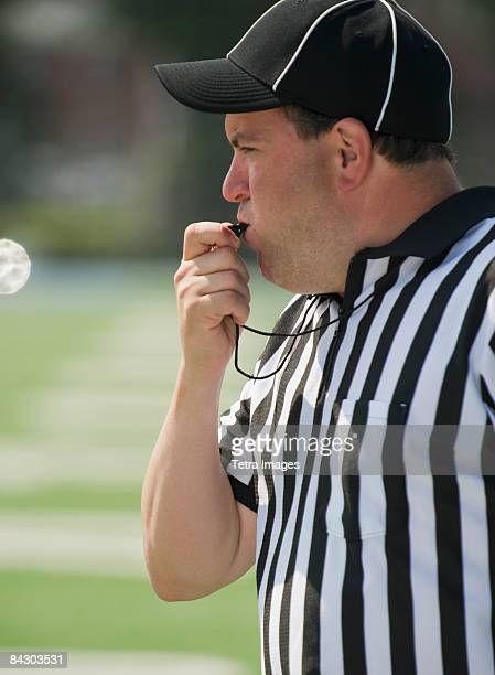 football referee blowing whistle - american football judge stock pictures, royalty-free photos & images