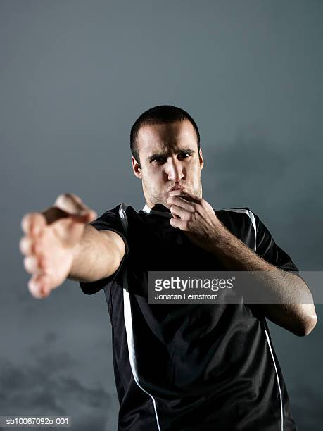 football referee blowing whistle, portrait - referee stock pictures, royalty-free photos & images
