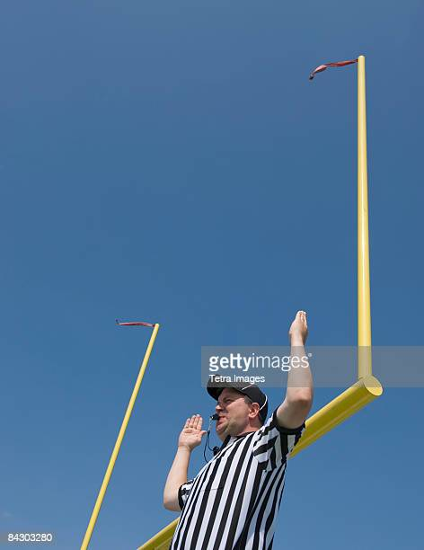 Football referee calling field goal