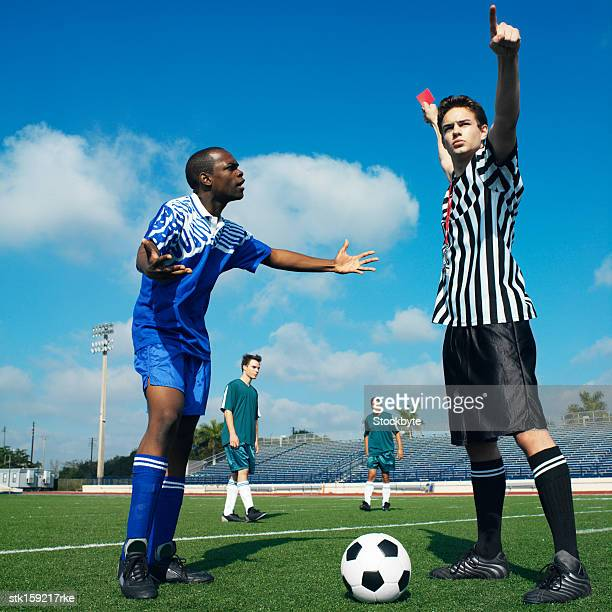football referee showing a player the red card
