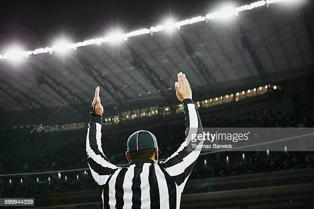 football referee signaling touchdown in stadium - american football referee stock pictures, royalty-free photos & images