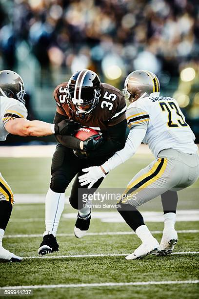 football running back breaking past defenders - rush american football stock pictures, royalty-free photos & images