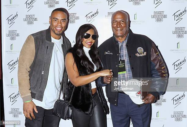 Football running back Rashad Jennings singer/songwriter Ashanti and actor John Amos attend the 2015 Giant Night of Comedy at Gotham Comedy Club on...