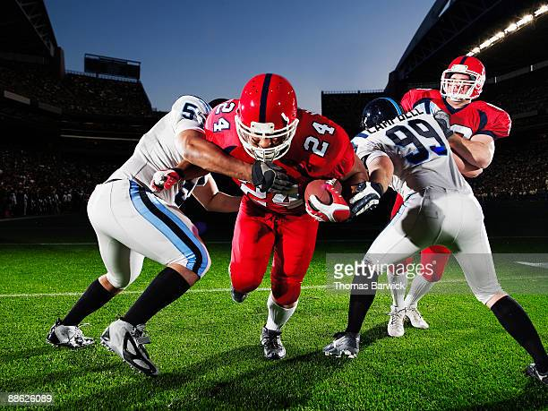 football running back running through defendersh - tackling stock pictures, royalty-free photos & images