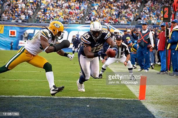 San Diego Chargers Antonio Gates in action scoring touchdown vs Green Bay Packers Morgan Burnett at Qualcomm Stadium San Diego CA CREDIT John W...