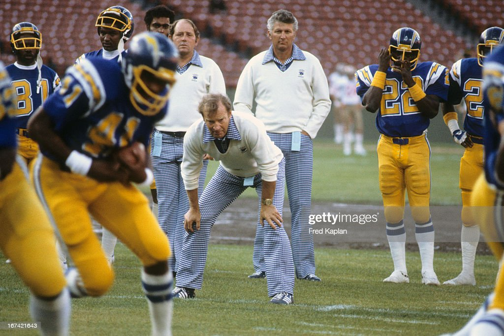 San Diego Chargers head coach Don Coryell with hands on knees with players on field before preseason game vs San Francisco 49ers at Candlestick Park. Fred Kaplan F17 )