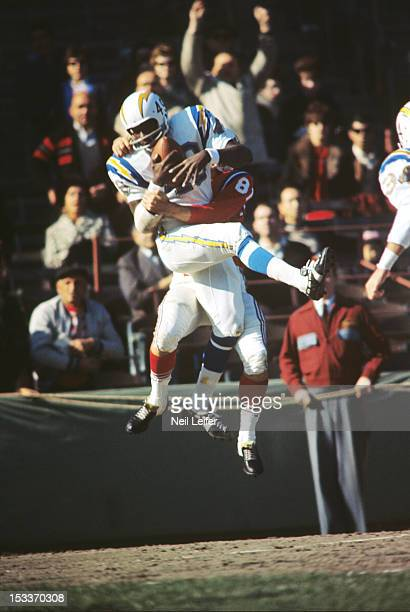 San Diego Chargers Jimmy Warren in action making catch for interception vs Boston Patriots at Fenway Park Boston MA CREDIT Neil Leifer