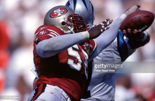 San Francisco 49ers Chris Doleman in action forcing fumble vs Carolina Panthers QB Steve Beuerlein at Ericcson Stadium Charlotte NC CREDIT Peter Read...