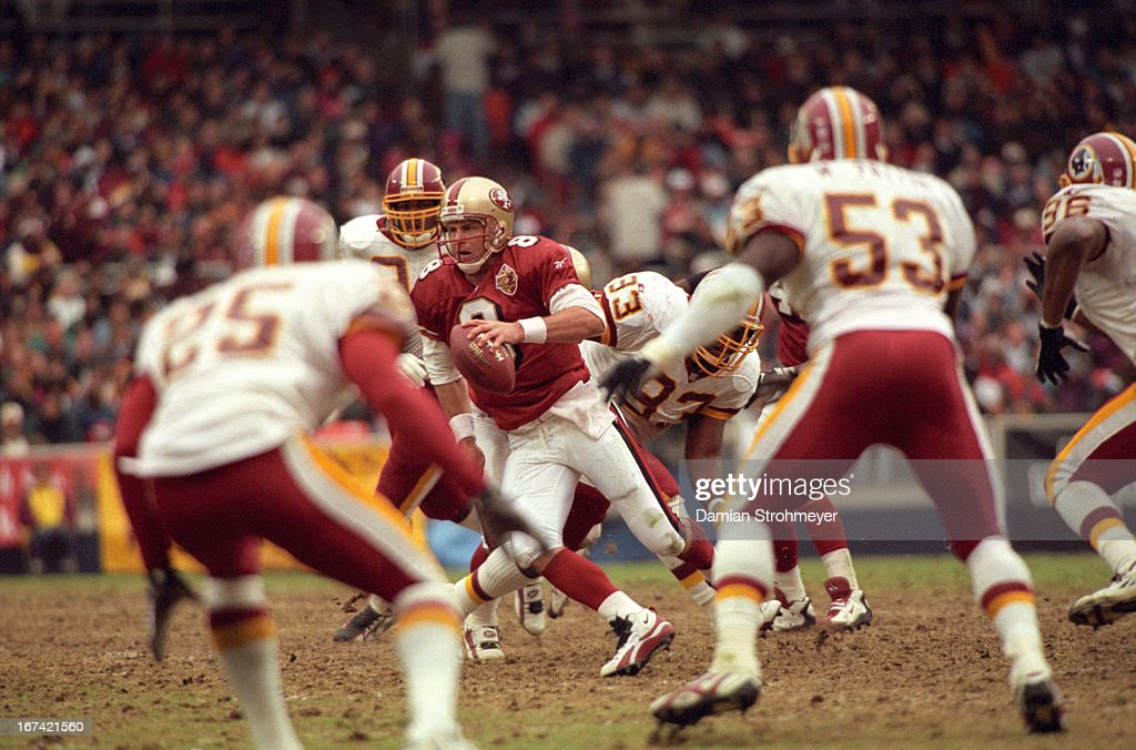 San Francisco 49ers QB Steve Young (8) in action vs Washington Redskins at RFK Stadium. Damian Strohmeyer F18 )