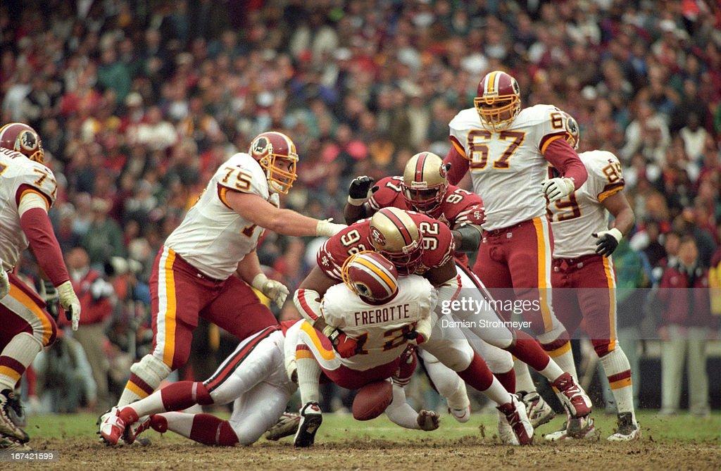 San Francisco 49ers Roy Barker (92) in action, making sack vs Washington Redskins QB Gus Frerotte (12) at RFK Stadium. Damian Strohmeyer F4 )