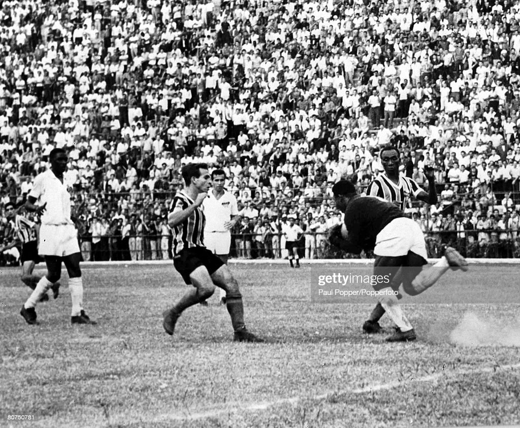 Football Sao Paulo, Brazil, 1957. Legendary Brazilian footballer Pele pictured making a save as a seventeen year old when he was a goalkeeper in the Brazilian league. : News Photo