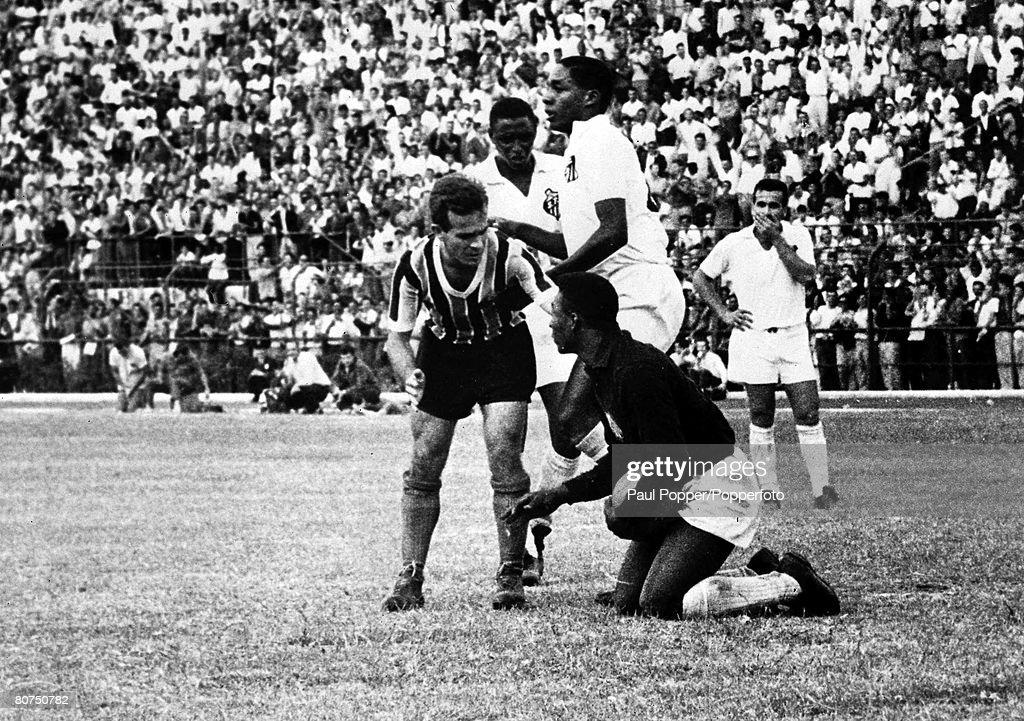 Football Sao Paulo, Brazil, 1957. Legendary Brazilian footballer Pele pictured making a save as a seventeen year old when he was a goalkeeper in the Brazilian league. : News Photo
