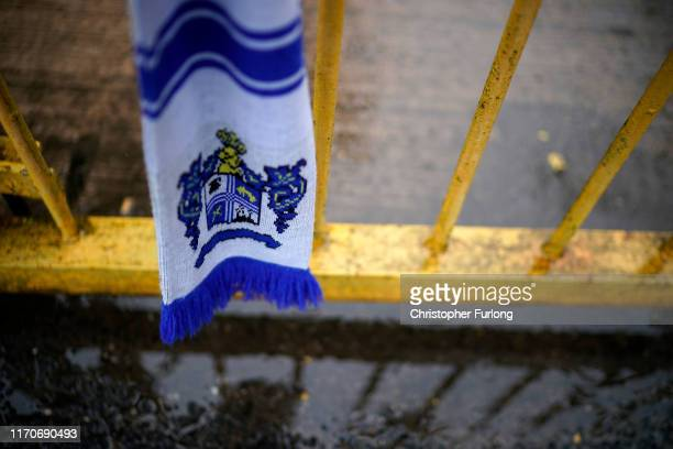 Football scarves gang from the locked gate of Gigg Lane Stadium the home of Bury Football Club who have been expelled from the English Football...