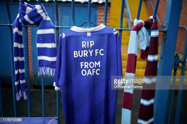 Football scarves hang from the locked gates of Gigg Lane Stadium the home of Bury Football Club who have been expelled from the English Football...