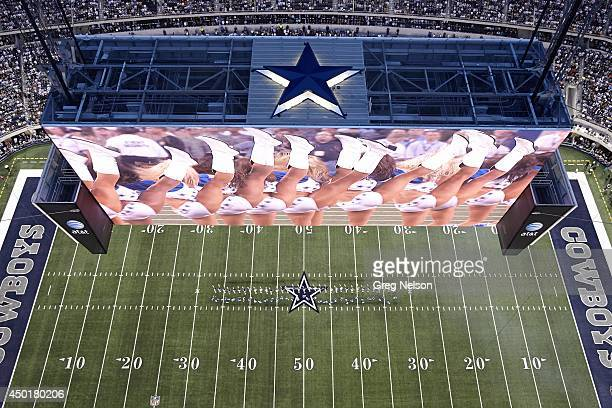 Scenic aerial view of cheerleaders in action on HD scoreboard before Dallas Cowboys vs New York Giants game at Cowboys Stadium Overall view of field...