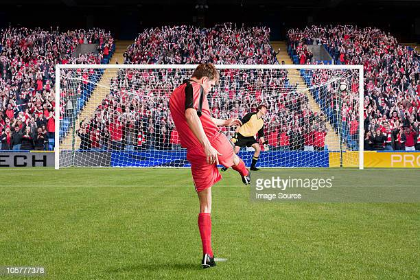 football scoring a goal - scoring a goal stock pictures, royalty-free photos & images