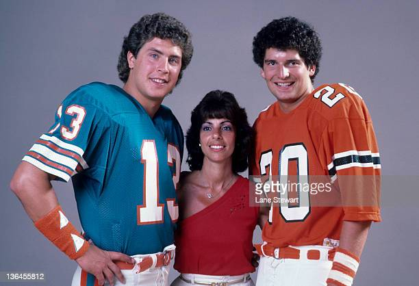 Season Preview Portrait of Miami Dolphins QB Dan Marino and Miami QB Bernie Kosar with Sports Illustrated baseball photo editor Laurel Frankel during...
