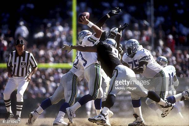 Football Seattle Seahawks QB Rick Mirer in action during sack by Oakland Raiders Aundray Bruce Oakland CA 10/8/1995