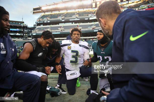 Seattle Seahawks QB Russell Wilson praying with Philadelphia Eagles players after game at Lincoln Financial Field Philadelphia PA CREDIT Rob Tringali