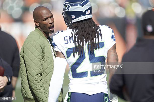 Seattle Seahawks Richard Sherman speaking with former Cincinnati Bengals wide receiver Chad Johnson on field before game at Paul Brown Stadium...