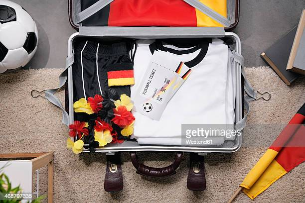 football shirt , tickets and fan articles packed in suit case, studio shot - traje de fútbol fotografías e imágenes de stock