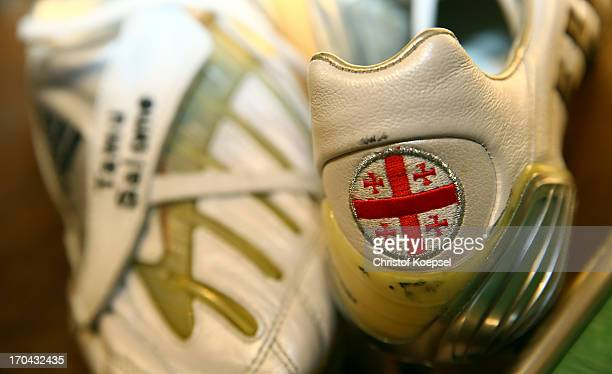 Football shoes of former player Levan Kobiashvili of Schalke with the national flag of Georgia at Schachtschatz Museum coal-mine Hugo tray two on...