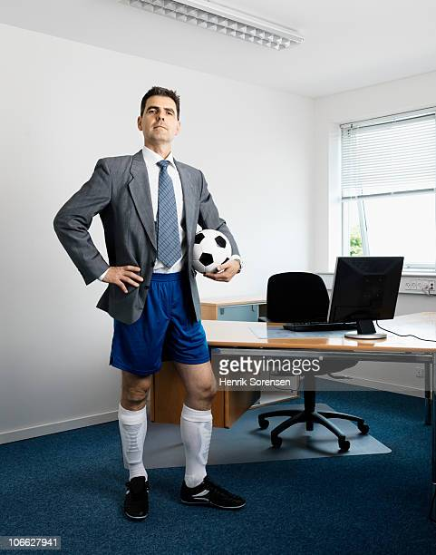 football shoes wearing businessman with ball - shorts stock pictures, royalty-free photos & images