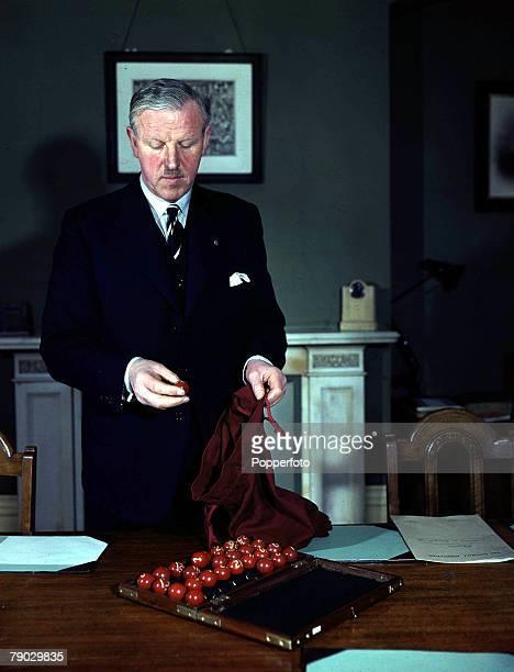Football Sir Stanley Rous FA Secretary with balls and bag used in the FA Cup draw1946